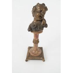Cabeza de niña de bronce